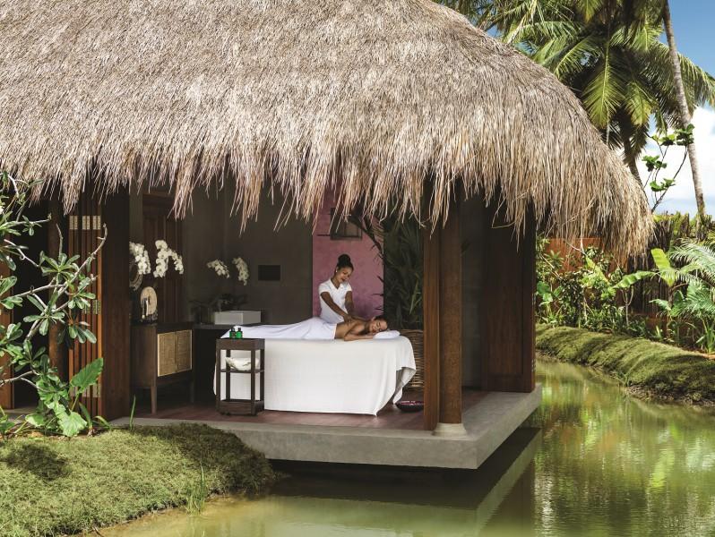 Spa massage at outdoor treatment pavillion